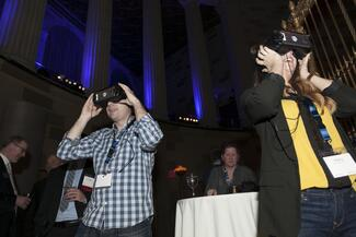 Attendees wearing virtual reality headsets
