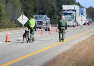 Law enforcement officers at a roadside checkpoint
