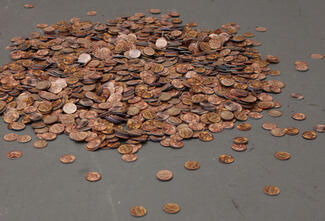 A big pile of pennies crafted from paper.