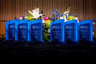 Blue glass awards on a table