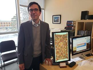 Jorge Grossman with an image of a tapestry