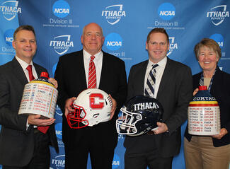 Athletic directors and football coaches from Ithaca College and Cortland State hold the Cortaca Jugs