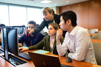 students work on projects in an accounting analytics class