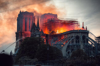 Flames rising above Notre Dame Cathedral