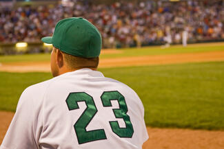 minor league baseball player looks across the field