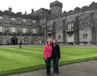 two students in front of a castle in Ireland