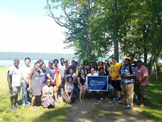 IC community members at a 2018 ICUnity event by Cayuga Lake