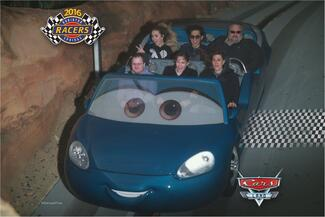 A group of six masters degree students rides a Cars-themed ride at Disneyland.