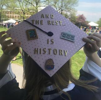 "Decorated graduation cap with the slogan ""And the rest is history"""
