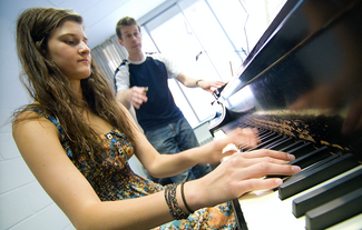 High school student working with faculty in IC's Summer Piano Institute