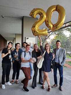 Students, alumnus, and faculty celebrating the department's 20th anniversary.