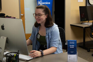 Student employee working at a computer