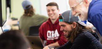 Professor John Barr works with students in class