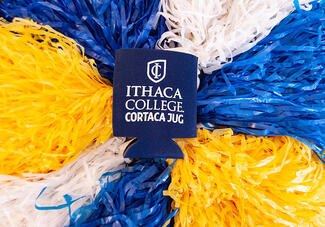 Cortaca Koozie on blue, white and yellow pom-poms