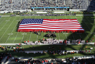 A giant American flag on a football field