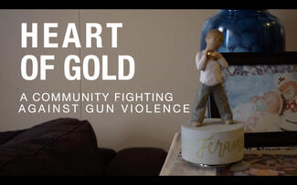 "A statue on a desk with the words ""HEART OF GOLD"" superimposed"