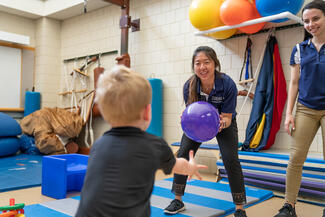 Physical therapy students work with children