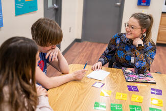 speech pathology student works with children