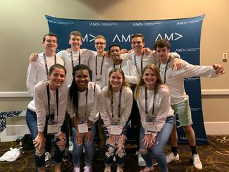 Members of Ithaca College's AMA at a conference