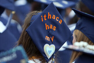 "mortarboard with the words ""Ithaca as my heart"""
