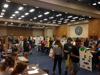 Student organization fair with tables with display posters on them