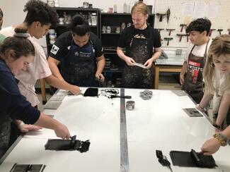group of students using ink and type