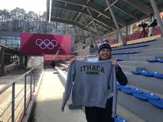 Kristen Gowdy shows her IC sweatshirt at the PyeongChang Olympics.