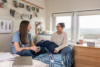 Students talking in a residence hall
