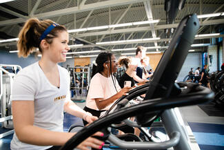 students on exercise equipment in the Fitness Center