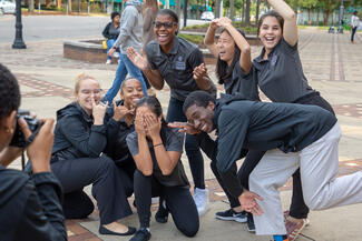 A group of MLK Scholars doing funny poses for the camera