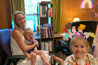Lauren Britton and her children working from home