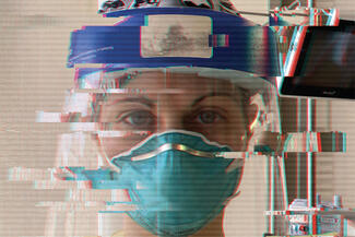 nurse in mask and face shield