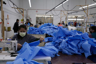 gowns being sewn into PPE
