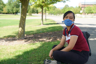 student wearing a mask on the quad
