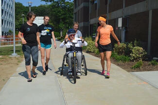 Carrie Callahan '02 (left) and Kelly Pantason '15 (right) with a patient.