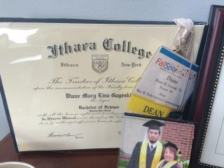 Dean Gayeski's Ithaca College diploma and a picture of her son's graduation from IC