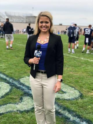 First year student Tara Lynch on the field reporting Bombers Football live for ICTV during her first semester.