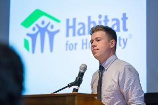 Student presenting his work for Habitat for Humanity