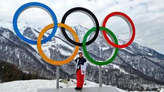 coach with olympic rings