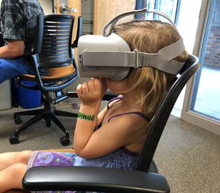 Young girl in a VR headset