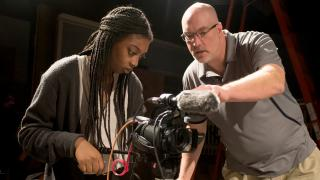 Dr. James Rada teaching a student to operate a camera