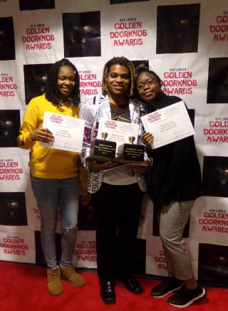 Three young women posing with awards