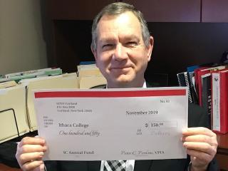 man holding a check