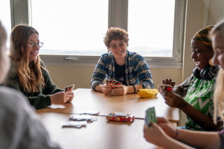 Students playing a card game.