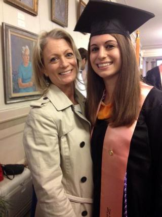 woman in graduation gown and mortarboard with mom