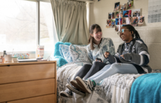 Students on dorm bed