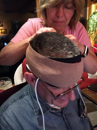 woman putting sensors on a man's head