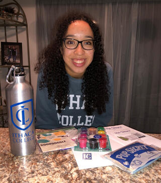 Mikayla Tolliver with the supplies from her Fall Welcome Box