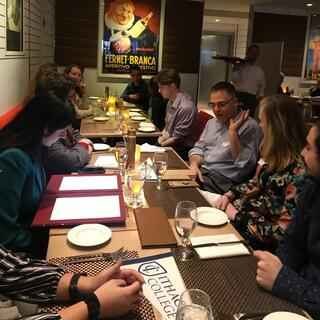 Students and alumni having a networking dinner