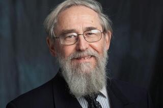 man with glasses and a beard